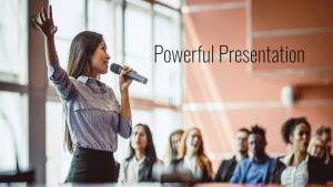 Image of a women standing in front of a crowd with a microphone